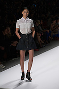 A short  skirt with white pattered blouse by Richard Chai at the Spring 2013 Mercedes Benz Fashion Week show in New York.