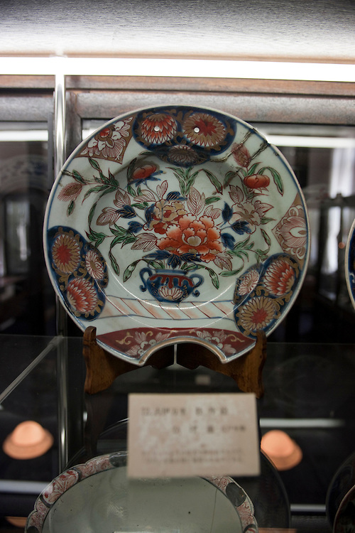 Ko Imari  Porcelain   (old Imari) , Imari  is actually made in  Arita  but shipped  exclusively overseas,  and bares designs often considered garish by Japanese standards but highly sought after by wealthily europeans...It  takes it name from the  the  port town of Imari  where the ships  of europe merchants were allowed to trade