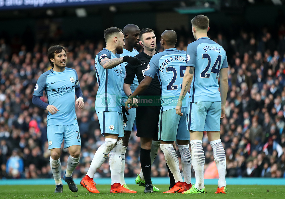 Manchester City's players protest to referee Michael Oliver after he awards Liverpool a penalty during the Premier League match at the Etihad Stadium, Manchester.