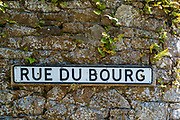 Rue du Bourg, French road name sign set in dry stone wall in St Clements region of Jersey, Channel Isles
