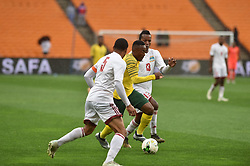 South Africa: Johannesburg: Bafana Bafana player Lebohang Maboe battle for the ball with Seychelles players Jones Joubert Colin Esther during the Africa Cup Of Nations qualifiers at FNB stadium, Gauteng.<br />