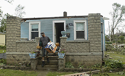 May 29, 2019 - Dayton, Ohio, U.S. - A Man helps his Ant remove her belonging of the home . After the Tornado took off the roof and side of the home. His Ant was trapped  inside the home during the Tornado. (Credit Image: © Ernest Coleman/ZUMA Wire)