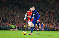 LONDON, ENGLAND - Saturday, November 22, 2014: Manchester United's Wayne Rooney scores the second goal against Arsenal during the Premier League match at the Emirates Stadium. (Pic by David Rawcliffe/Propaganda)