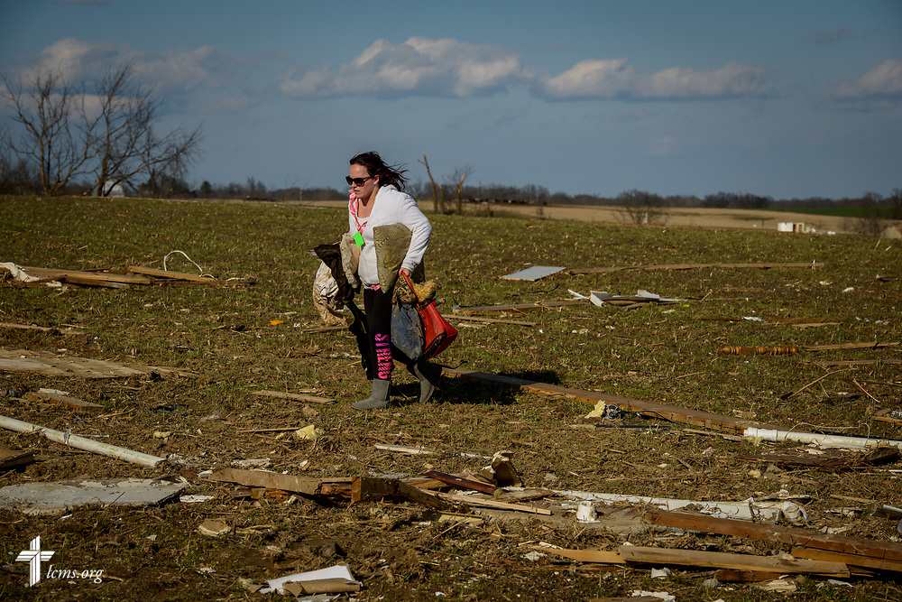 Volunteer Jamie Stenberg helps collect personal belongings for a tornado victim on Wednesday, March 1, 2017, in Perryville, Mo. LCMS Communications/Erik M. Lunsford