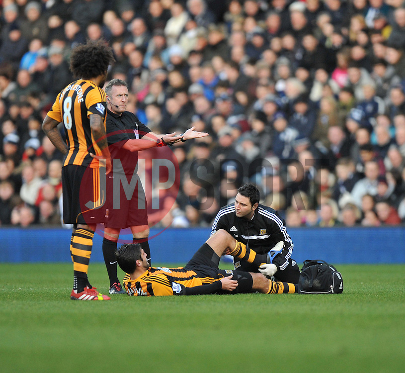 Hull City's Danny Graham gets treatment. - Photo mandatory by-line: Alex James/JMP - Tel: Mobile: 07966 386802 21/12/2013 - SPORT - FOOTBALL - The Hawthorns - West Bromwich - West Brom v Hull City - Barclays Premier League