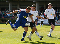Photo: Steve Bond/Richard Lane Photography. Hereford United v Leicester City. Coca Cola League One. 11/04/2009. Steve Howard (L) is grappled by Kris Taylor (R)