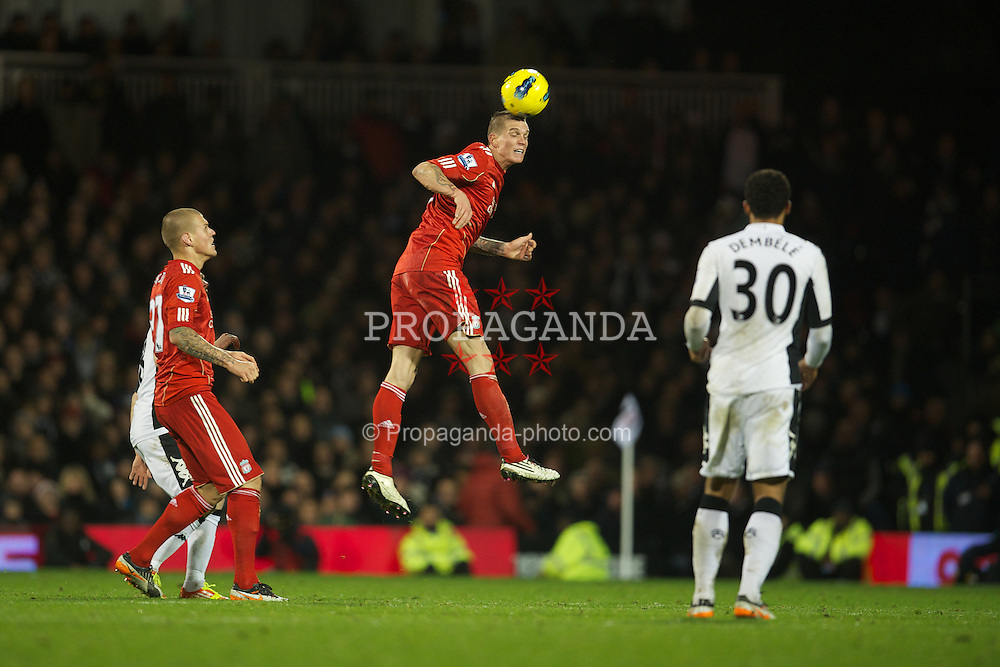 LONDON, ENGLAND - Monday, December 5, 2011: Liverpool's Daniel Agger in action against Fulham during the Premiership match at Craven Cottage. (Pic by David Rawcliffe/Propaganda)