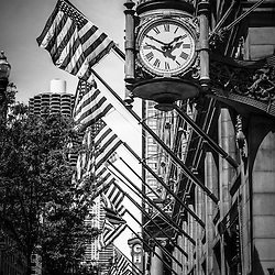 Chicago Macy's clock in black and white (formerly Marshall Field's), Chicago Theatre sign, and Marina City Towers in downtown Chicago.