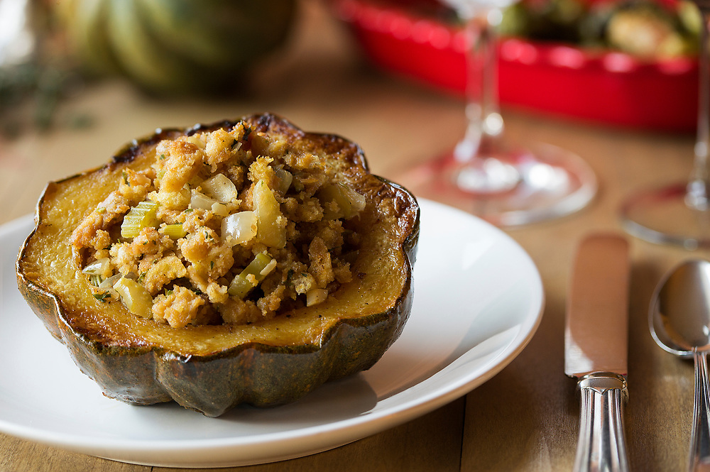 Stuffed, baked acorn squash on dinner table