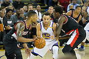 Golden State Warriors guard Stephen Curry (30) fights through a Portland Trail Blazers screen at Oracle Arena in Oakland, Calif., on October 21, 2016. (Stan Olszewski/Special to S.F. Examiner)