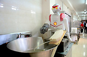 SHENYANG, CHINA - MAY 09: <br /> <br /> Robots Shave Noodles At  School Canteen <br /> <br /> A robot slices noodles for students at Shenyang Agricultural University on May 9, 2017 in Shenyang, Liaoning Province of China. Sliced noodles made by the two robots serve in the school canteen of Shenyang Agricultural University. <br /> ©Exclusivepix Media