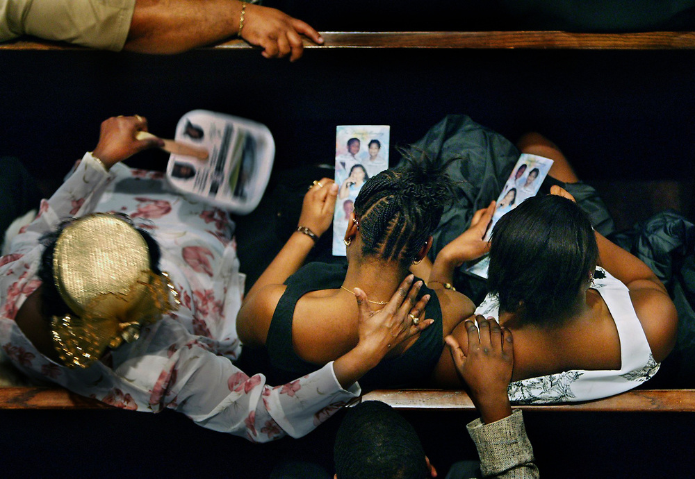 Thousands of family members, friends and strangers mourn  Lisa Shelton, and her children Wrandell Parker, WaNee Parker, William Parker Jr., and Aushanai Thompson during funeral services at the Mt. Zion Baptist Church, on Detroit's east side. The crowd overflowed the church.  April 7, 2004