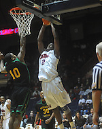 "Mississippi forward Reginald Buckner (2) dunks and is fouled by Southeastern Louisiana's Roosevet Johnson (10) at the C.M. ""Tad"" Smith Coliseum in Oxford, Miss. on Sunday, January 2, 2011. (AP Photo/Oxford Eagle, Bruce Newman)"