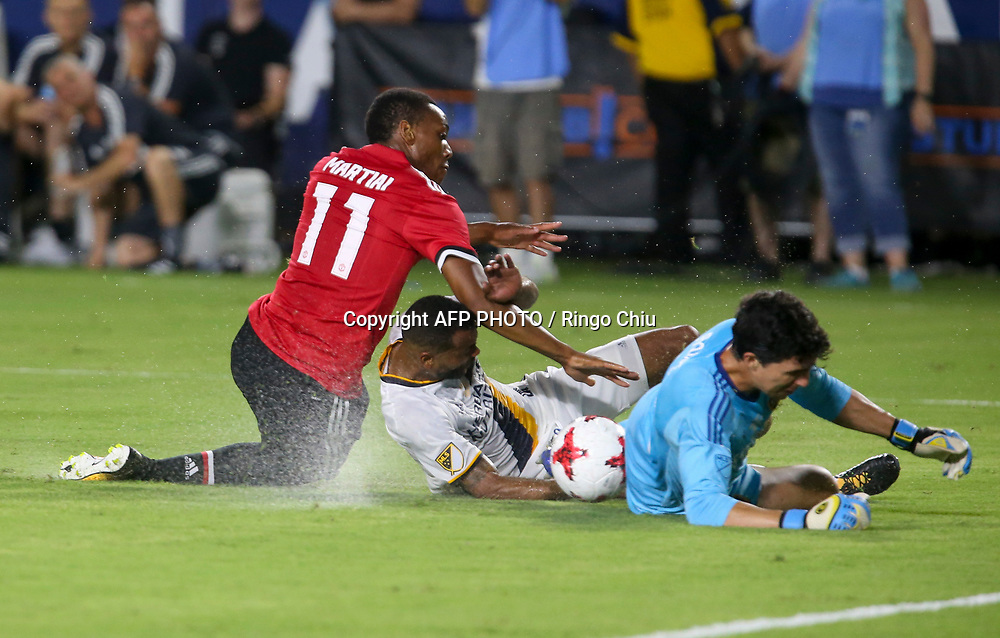Manchester United Anthony Martial, left, crashes with Los Angeles Galaxy during the second half of a national friendly soccer game at StubHub Center on July 15, 2017 in Carson, California. The Manchester United won 5-2. AFP PHOTO / Ringo Chiu