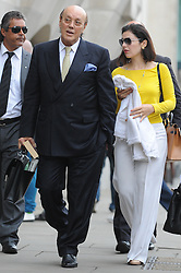 © Licensed to London News Pictures. 15/08/2012. London,UK.Cypriot businessman Asil Nadir arriving at Central Criminal Court, Old Bailey, in London with his wife Nur Nadir on August 15, 2012 where the jury is currently considering a verdict in the Polly Peck fraud case. Nadir, who fled to Cyprus in 1993 after the charges were first brought, is accused of £34m fraud at his firm Polly Peck .  Photo credit : Thomas Campean/LNP
