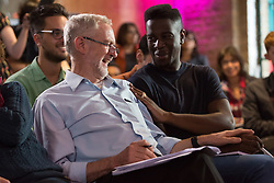 © Licensed to London News Pictures. 01/09/2015. London, UK. Jeremy Corbyn shares a joke with Jermain Jackman at the Arcola Theatre in Dalston, east London this evening, where he launched his Vision for the future of the arts. Photo credit : Vickie Flores/LNP