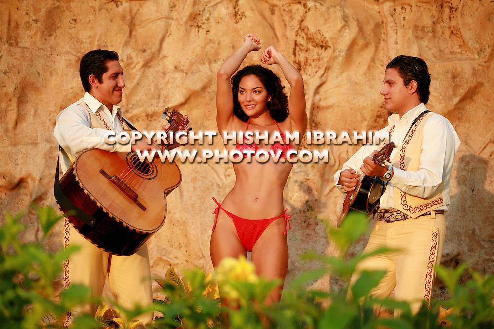 Sexy Brunette woman in bikini dancing to guitar music at beach, Cancun, Mexico