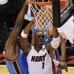 Jun 21, 2012; Miami, FL, USA; Miami Heat power forward Chris Bosh (1) drives to the basket against Oklahoma City Thunder center Kendrick Perkins (5) during the first quarter in game five in the 2012 NBA Finals at the American Airlines Arena. Mandatory Credit: Derick E. Hingle-US PRESSWIRE