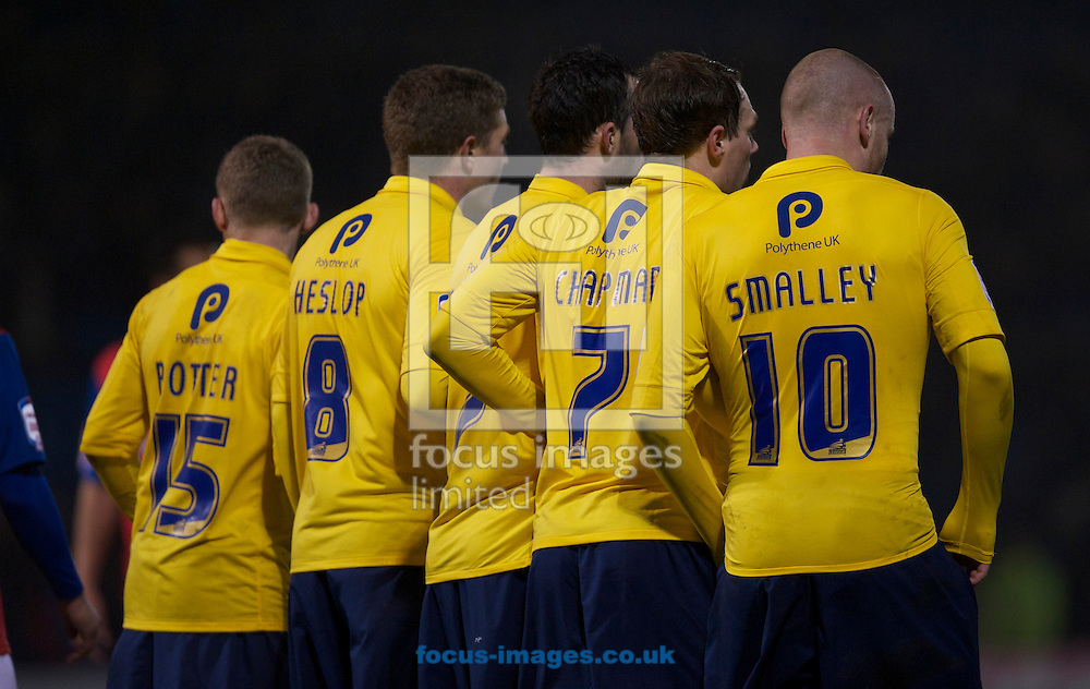 Picture by Alan Stanford/Focus Images Ltd +44 7915 056117.26/02/2013. Oxford United players form a wall during the npower League 2 match at the MEMS Priestfield Stadium, Gillingham.