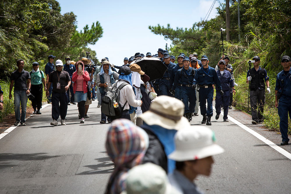 OKINAWA, JAPAN - SEPTEMBER 14 : Anti U.S base protesters is seen being removed by police after blocking the trucks to protest against the construction of helipads in front of the gate of U.S. military's Northern Training Area in the village of Higashi, Takae, Okinawa Prefecture, Japan on September 14, 2016. The Defense Ministry's Okinawa Defense Bureau started moving construction material and equipment into the area in order to complete the 6 helipads. (Photo by Richard Atrero de Guzman/NURPhoto)