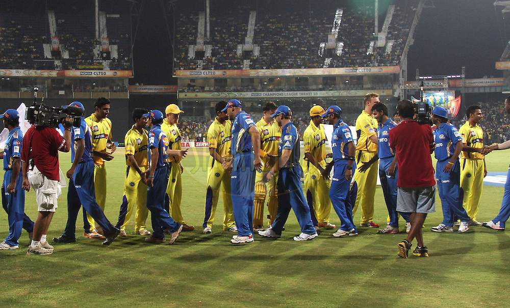layers shake hands before the start during match 3 of the NOKIA Champions League T20 ( CLT20 )between the Chennai Superkings and the Mumbai Indians held at the M. A. Chidambaram Stadium in Chennai , Tamil Nadu, India on the 24th September 2011..Photo by Shaun Roy/BCCI/SPORTZPICS