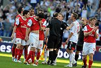 Reebok Stadium Bolton Wanderers v Arsenal  (2-1) 24/04/2011 Premier League<br />Dejected Cesc Fabregas and Arsenal as  their title hopes end<br />Photo: Roger Parker Fotosports International