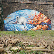 London,England,UK : 11th April 2016 : 'Endangered 13' Project, street artists painting  'Polar Bear' raising awareness Endangered animal at Ackroyd Drive, Sponsor by Tower Hamlets council in London. Photo by See Li