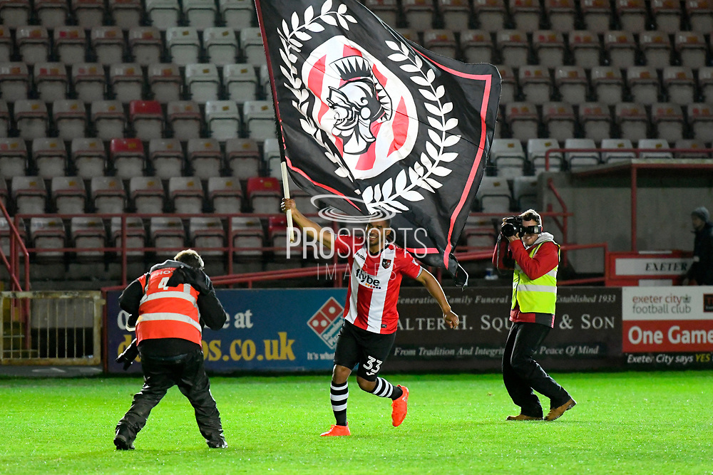 Reuben Reid (33) of Exeter City runs around the pich at full time with a giant flag in celebration of the 3-2 win over Carlisle during the EFL Sky Bet League 2 play off second leg match between Exeter City and Carlisle United at St James' Park, Exeter, England on 18 May 2017. Photo by Graham Hunt.