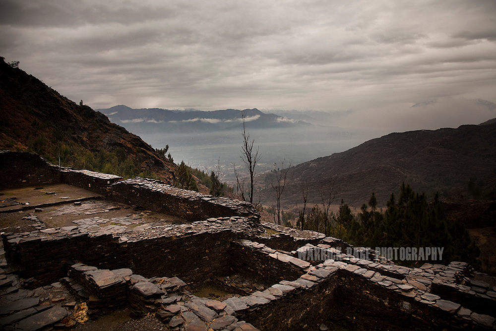 The ruins of a Gandhara Buddhist monastery are seen looking down into the Swat Valley, on February 12, 2011, outside Mingora, Pakistan. The monastery was converted into a mosque in 1048 A.D. and has since been known as the Ghaznavi Mosque. The Kingdom of Gandhara lasted from early 1st millennium BC to the 11th century AD, and was located in northern Pakistan and eastern Afghanistan. (Photo by Warrick Page)