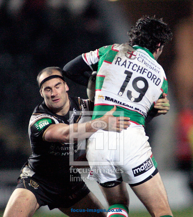 Picture by Richard Gould/Focus Images Ltd +447814 482222.23/02/2013.Danny Houghton of Hull Football Club stop Stefan Ratchford of Warrington Wolves during the Stobart Super League match at the KC Stadium, Kingston upon Hull.