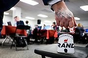 WASHINGTON, DC - February 1: A Rand Paul volunteer rings a cowbell to signify another committed voter for Presidential Candidate Rand Paul at Paul's Des Moines headquarters on February 1, 2016 in Des Moines, Iowa. Paul volunteers worked the phones in the final hours leading up to the start of the Iowa Caucus. (Photo by Pete Marovich/Getty Images)