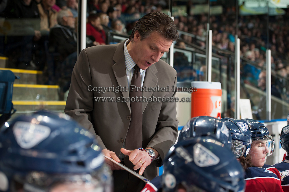 KELOWNA, CANADA - MARCH 8: Jim HIller, head coach of the Tri-City Americans discusses a play with his team on the bench against the Kelowna Rockets on March 8, 2014 at Prospera Place in Kelowna, British Columbia, Canada.   (Photo by Marissa Baecker/Getty Images)  *** Local Caption *** Jim Hiller;