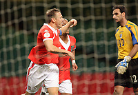 Photo: Rich Eaton.<br /> <br /> Wales v Cyprus. UEFA European Championships 2008 Qualifying. 11/10/2006. Captain of Wales Craig Bellamy left celebrates his second half goal as Cyprus keeper Michael Morphis looks on dejectedly