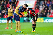 Arsenal Forward Olivier Giroud shakes hands with AFC Bournemouth defender Adam Smith after a late challenge on the Bournemouth player during the Barclays Premier League match between Bournemouth and Arsenal at the Goldsands Stadium, Bournemouth, England on 7 February 2016. Photo by Graham Hunt.
