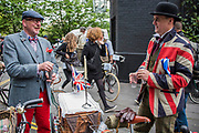 "A group brings their own towable cocktail basket - The Tweed Run - a group bicycle ride through the centre of London, in which the cyclists are expected to dress in traditional British cycling attire, particularly tweed plus four suits. Any bicycle is acceptable on the Tweed Run, but classic vintage bicycles are encouraged in an effort to recreate the spirit of a bygone era. The ride dubs itself ""A Metropolitan Cycle Ride With a Bit of Style."" London 06 May 2017"