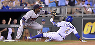 June 30, 2017 - Kansas City, MO, USA - The Kansas City Royals' Alcides Escobar reaches third before the throw to Minnesota Twins third baseman Miguel Sano on a triple in the sixth inning at Kauffman Stadium in Kansas City, Mo., on Friday, June 30, 2017. (Credit Image: © John Sleezer/TNS via ZUMA Wire)