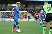 AFC Wimbledon striker Lyle Taylor (33) taking on Plymouth Argyle defender Aaron Taylor-Sinclair (17) during the EFL Sky Bet League 1 match between AFC Wimbledon and Plymouth Argyle at the Cherry Red Records Stadium, Kingston, England on 21 October 2017. Photo by Matthew Redman.