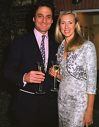 COUNT & COUNTESS ALLESANDRO GUERRINI-MARALDI at a dinner in London on 24th May 1999.MSK 99