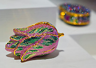 Roslyn, New York, U.S. - April 12, 2014 - During International Slow Art Day, a rhinestone Minaudiere collection, including a pink and green tulip bag, is part of the Garden Party exhibit at the Nassau County Museum of Art on Long Island. During this annual worldwide event, those participating went to local museums and viewed a small number of works of art, each for at least 10 minutes, and then discussed them afterward.