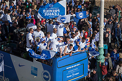 Brighton & Hove Albion open top bus parade passes Brighton Pier, Brighton players celebrate onto of the bus - Mandatory by-line: Jason Brown/JMP - 14/05/17 - FOOTBALL - Brighton and Hove Albion, Sky Bet Championship 2017 - Brighton and Hove Albion Promotion Parade