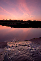 Creek Drains into Upper Newport Bay at Sunset with Contrails in the Sky, Newport Beach, California