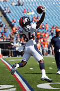 Denver Broncos rookie wide receiver Isaiah McKenzie (84) catches a pass while warming up before the 2017 NFL week 3 regular season football game against the against the Buffalo Bills, Sunday, Sept. 24, 2017 in Orchard Park, N.Y. The Bills won the game 26-16. (©Paul Anthony Spinelli)