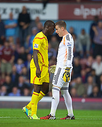 LONDON, ENGLAND - Saturday, September 20, 2014: Liverpool's Mario Balotelli clashes with West Ham United's goalkeeper Adrian during the Premier League match at Upton Park. (Pic by David Rawcliffe/Propaganda)