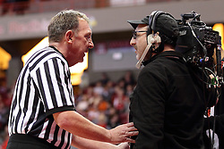 15 January 2016: Referee David Hall chats with an ESPN videographer about where he is allowed to be during the Illinois State Redbirds v Evansville Purple Aces at Redbird Arena in Normal Illinois (Photo by Alan Look)
