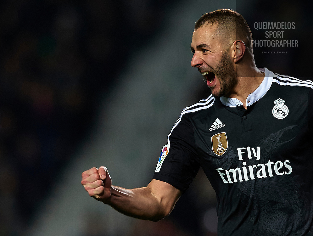 ELCHE, SPAIN - FEBRUARY 22:  Karim Benzema of Real Madrid celebrates after scoring during the La Liga match between Elche FC and Real Madrid at Estadio Manuel Martinez Valero on February 22, 2015 in Elche, Spain.  (Photo by Manuel Queimadelos Alonso/Getty Images)