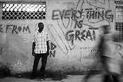 Zanzibar Town, Zanzibar -   2015-03-26  - A recovering addict stands next to an apartment building covered in graffiti  in Zanzibar Town, Zanzibar on March 26, 2015.  Photo by Daniel Hayduk