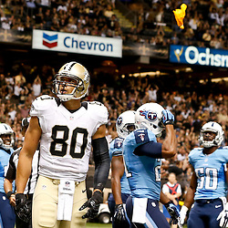 Aug 15, 2014; New Orleans, LA, USA; New Orleans Saints tight end Jimmy Graham (80) is flagged after dunking over the goalpost following a touchdown against the Tennessee Titans during second quarter of a preseason game at Mercedes-Benz Superdome. Mandatory Credit: Derick E. Hingle-USA TODAY Sports