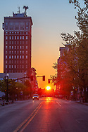 The sun rises perfectly aligned above the center of 4th Avenue downtown in Huntington, West Virginia.