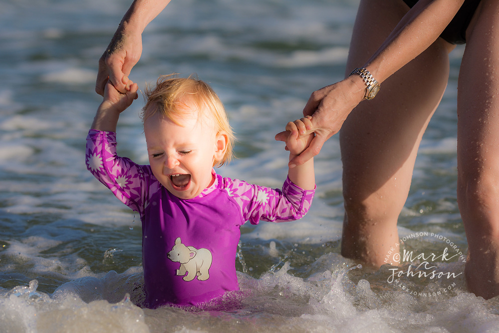 Happy 15 month old girl at the beach with her mother, Sunshine Coast, Queensland, Australia