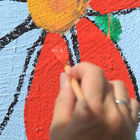 Kathryn Rhea, Director of Keep Tupelo Beautiful, adds some color to a the mural on the storm shelter on Front Street in Tupelo Wednesday. The project, started by Tupelo Ward 4 Councilwoman Nettie Davis, is to beautify the shelter in conjunction with Keep Tupelo Beautiful.